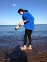 Hye-jin feeling the waters of Lake Superior